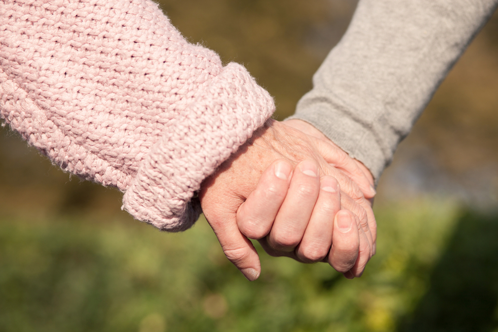 elderly couple holding hands, healthy sex after 40