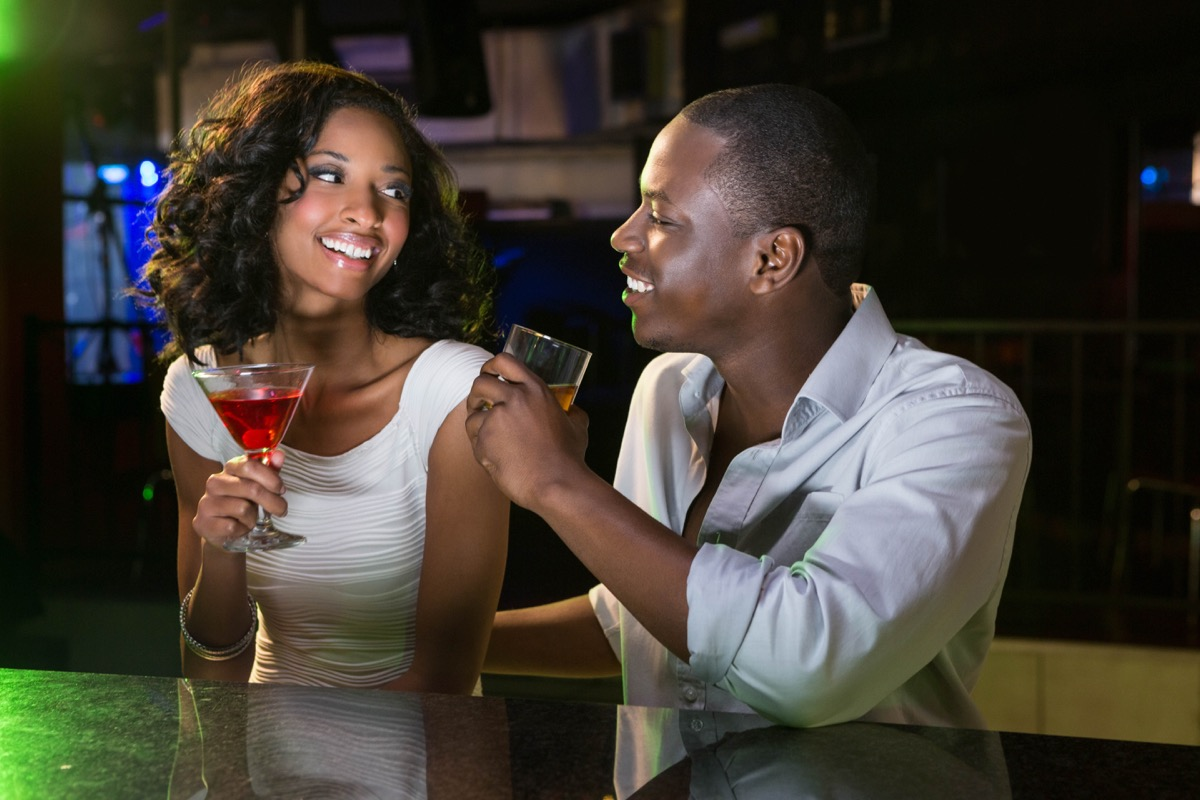 young black man and woman enjoy cocktails on date husband mistakes
