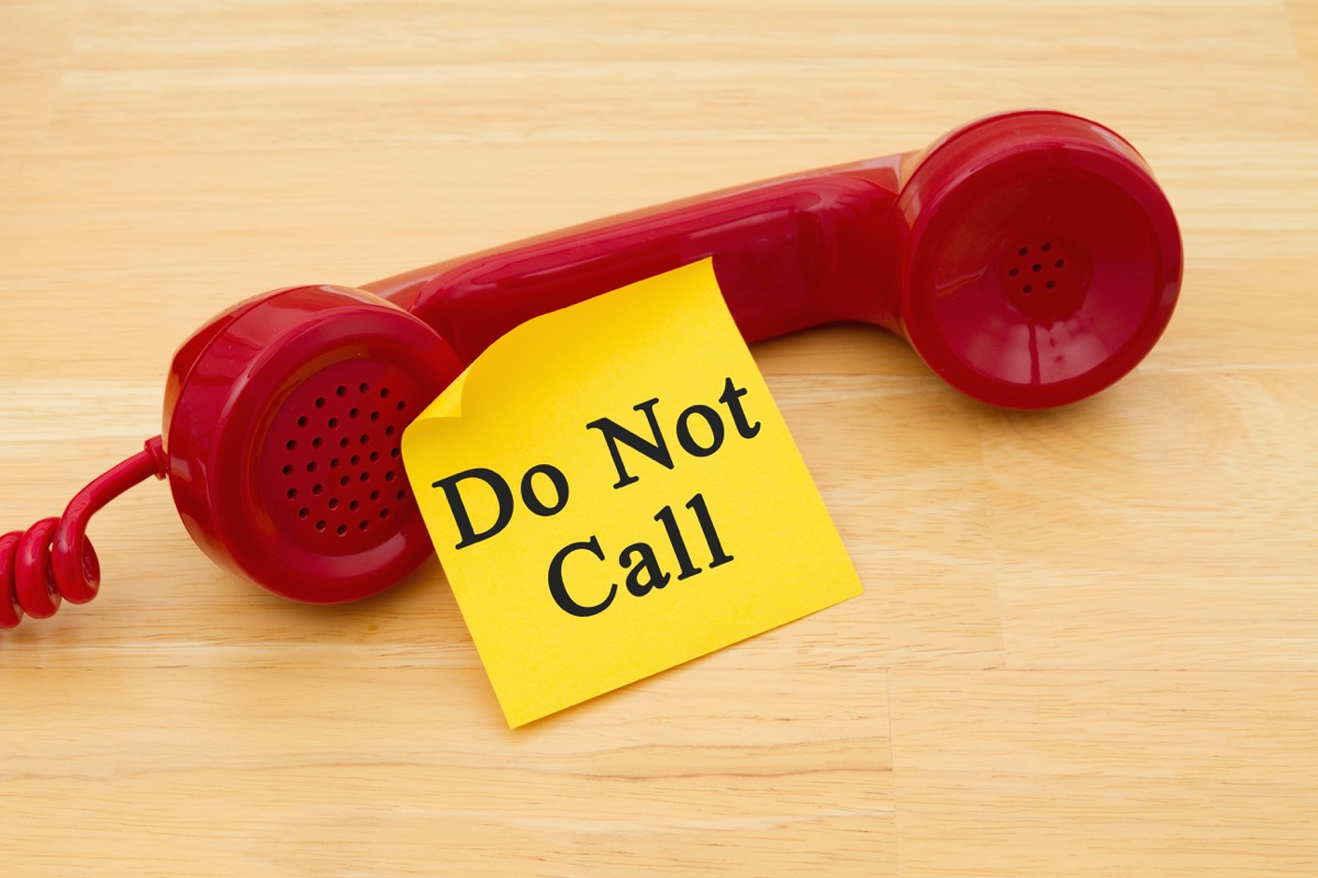 red phone with yellow paper that reads do not call