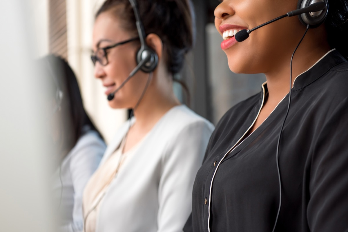row of telemarketers sitting up straight and smiling, telemarketer secrets