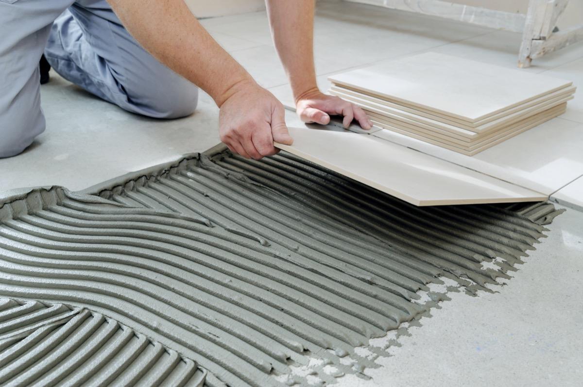 man adding tile floor to house, downgrade upgrades worst home upgrades