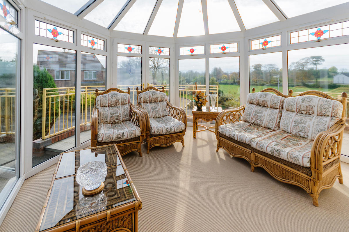 Household conservatory with cane furniture