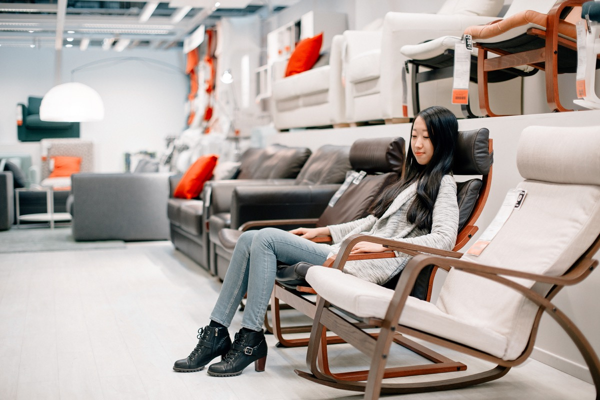 woman at furniture store sitting in seat