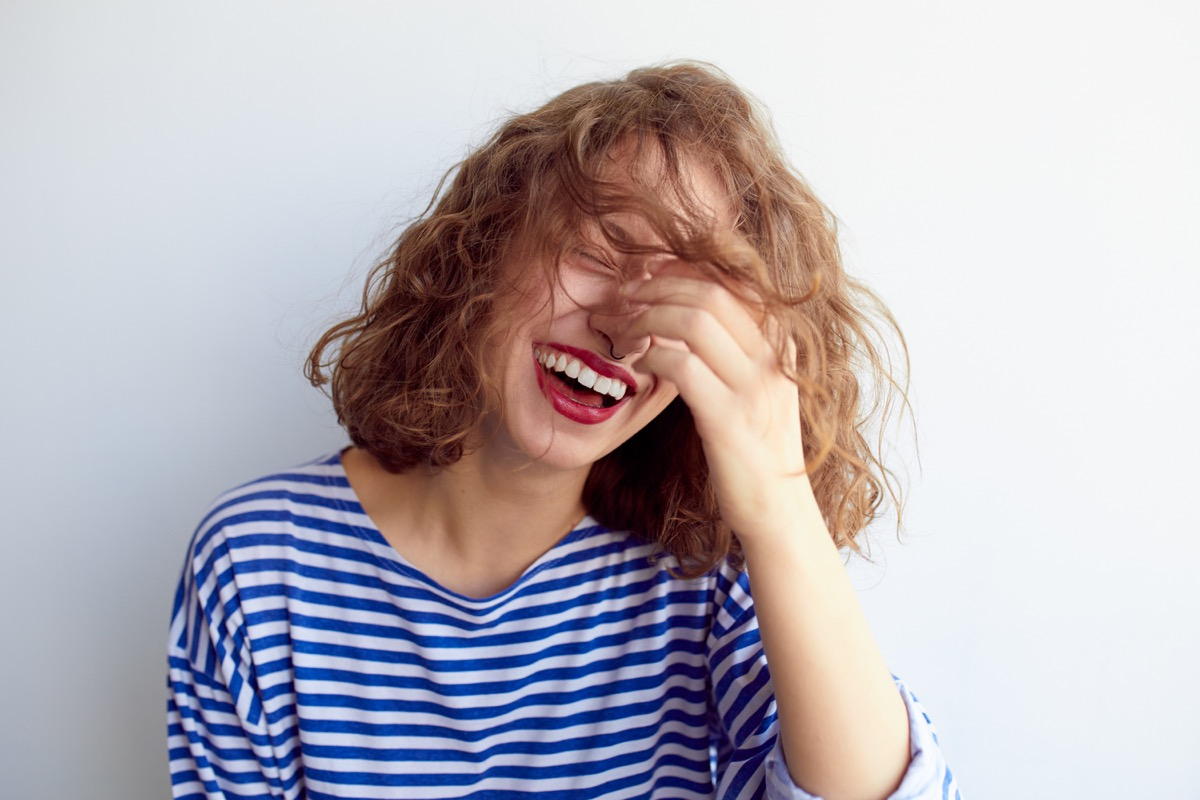woman laughing to herself, what do you call jokes