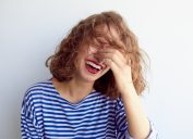woman laughing to herself