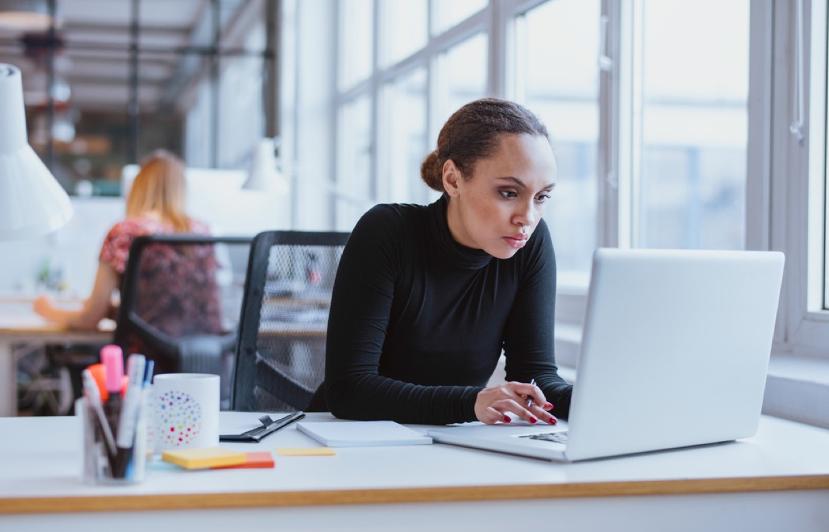 woman working on computer, office etiquette