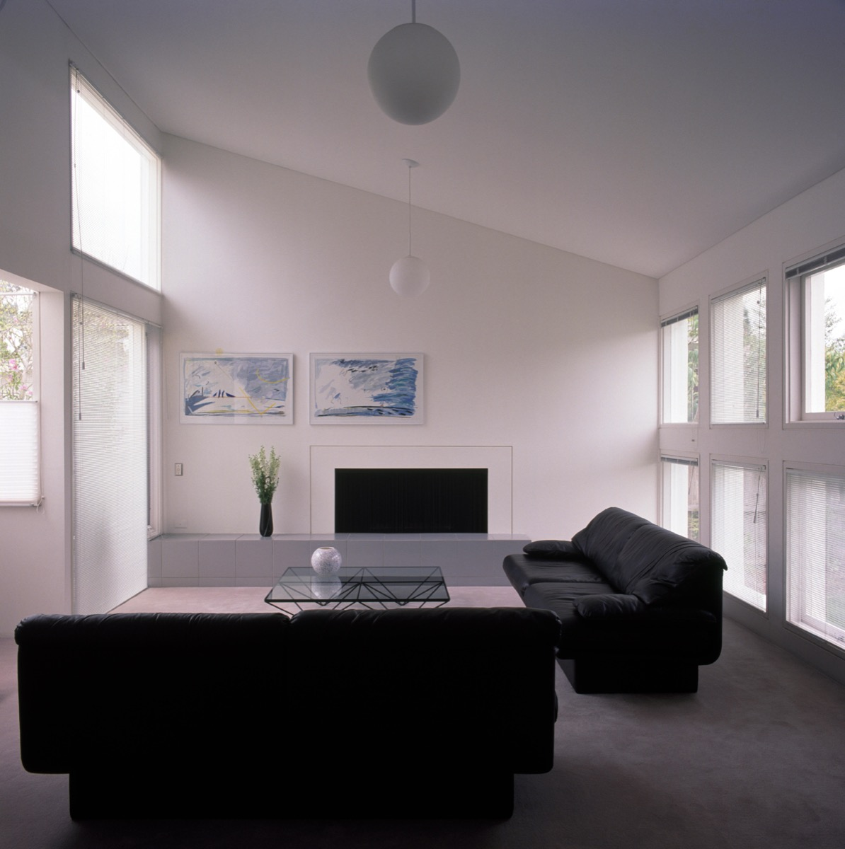 Black sofas in a minimalist style white living room