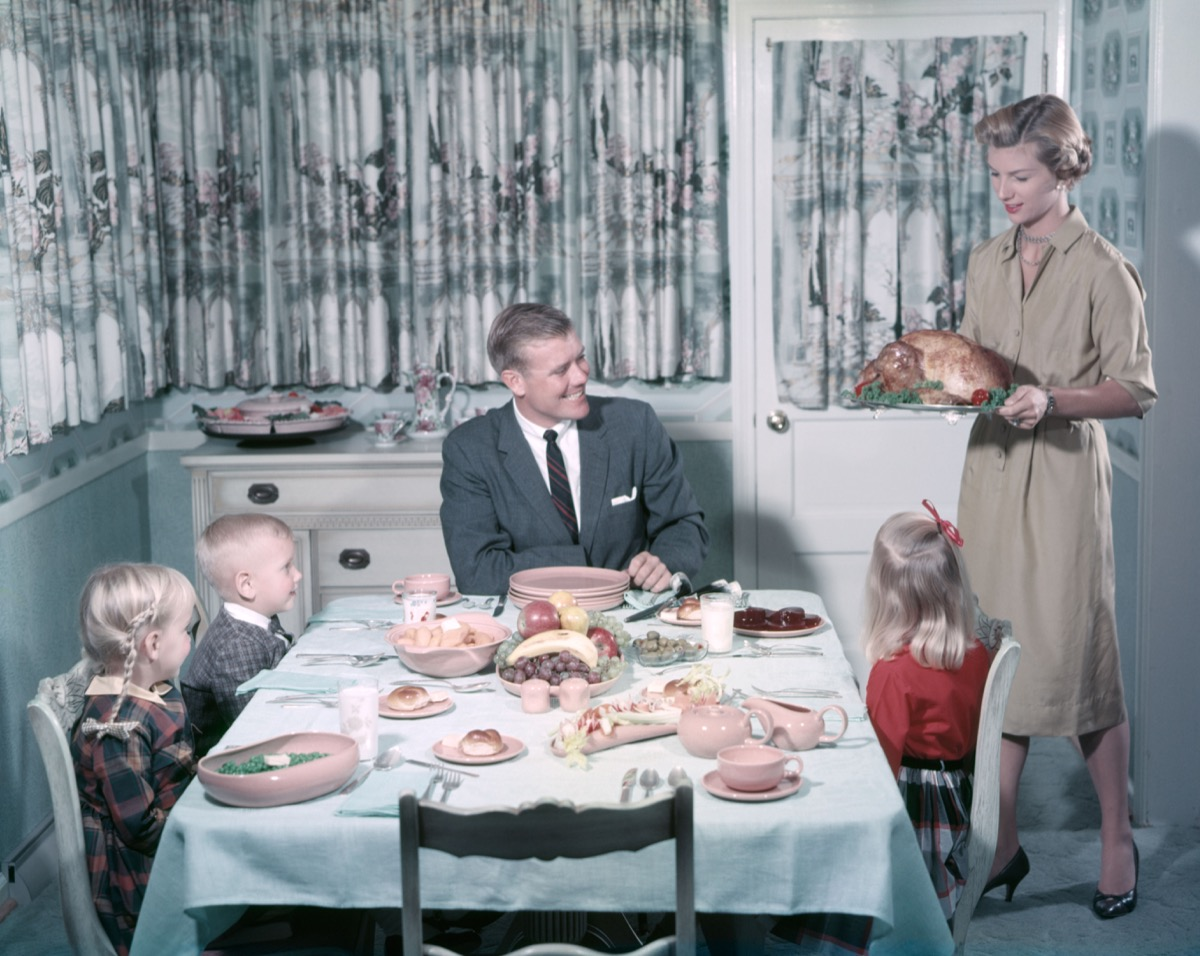 1950s family eats dinner at table, shows how different parenting was 50 years ago