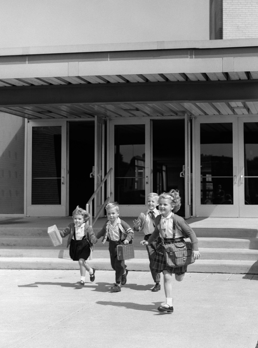 Four young children run free in 1950s from school, shows how different parenting was in the 1950s