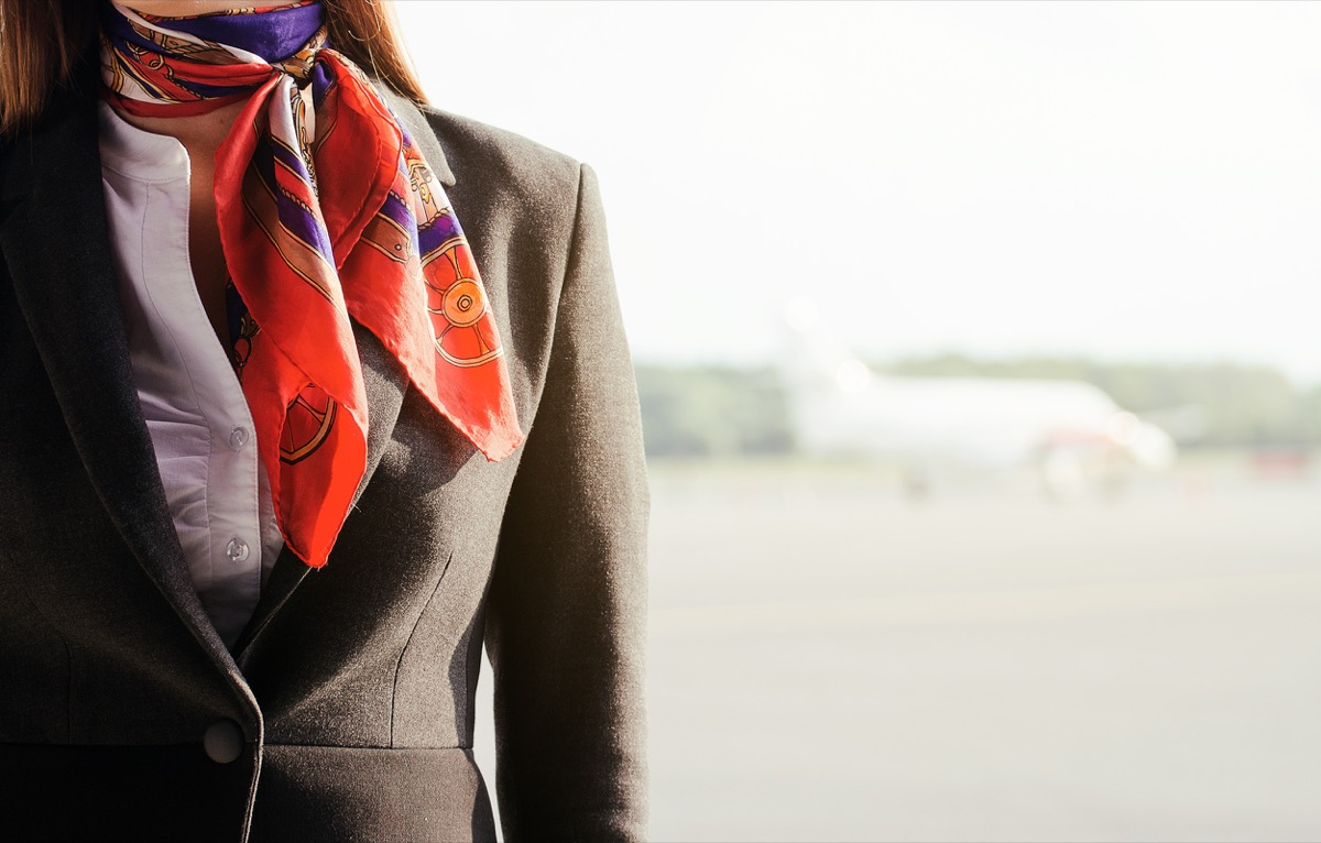 close up on flight attendant, no face shown, just scarf and jacket, flight attendant annoyances