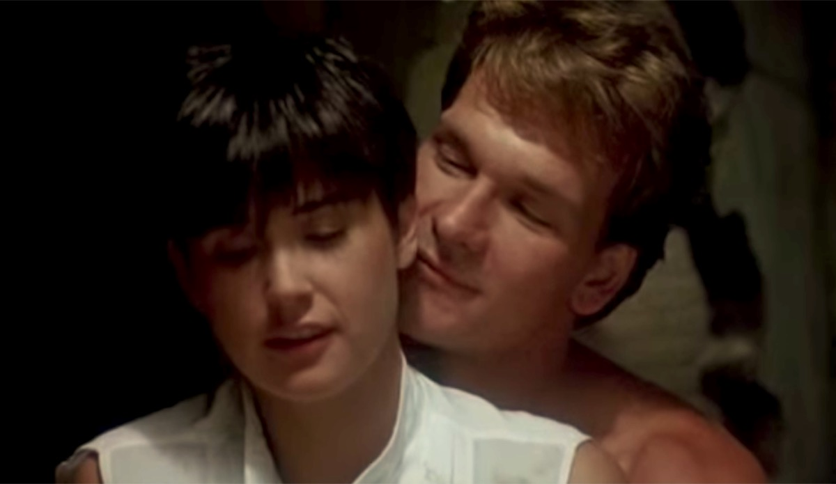 Demi Moore with cropped hair in white shirt sits at pottery wheel with patrick swayze behind her in ghost, things hollywood gets wrong about sex
