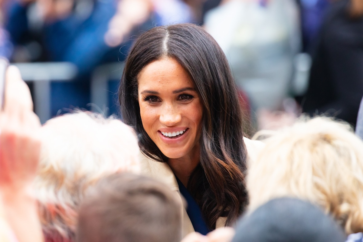 Baby Sussex Birth is imminent, photo of Meghan Markle smiling amidst crowd