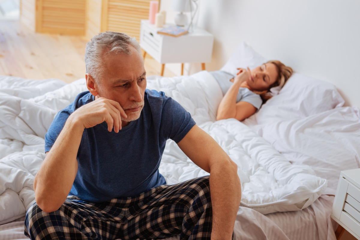 angry couple laying in bed, things you should never say to your spouse
