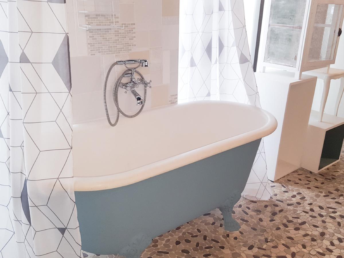 blue claw foot bath tub, vintage home upgrades