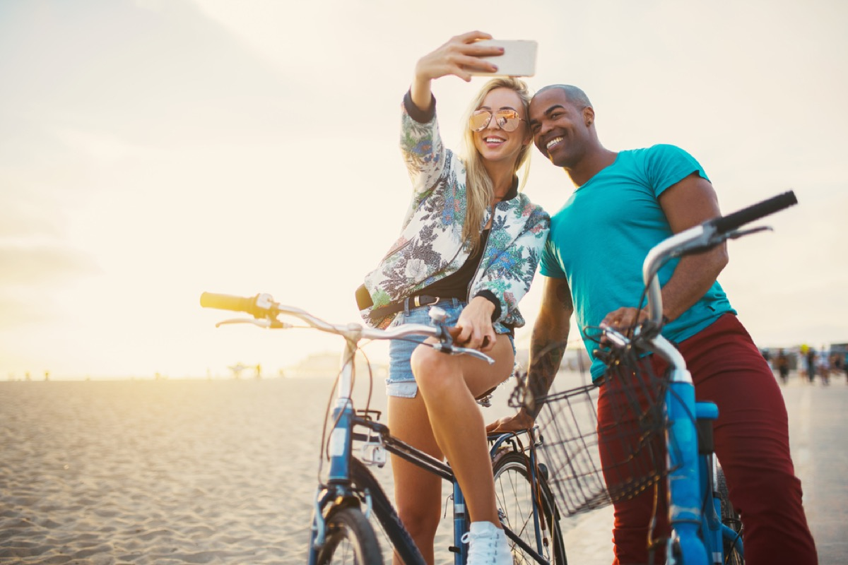 attractive interracial couple on bikes taking selfie signs you're in a relationship for the wrong reasons