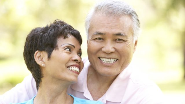 older couple being affectionate outdoors, long marriage tips