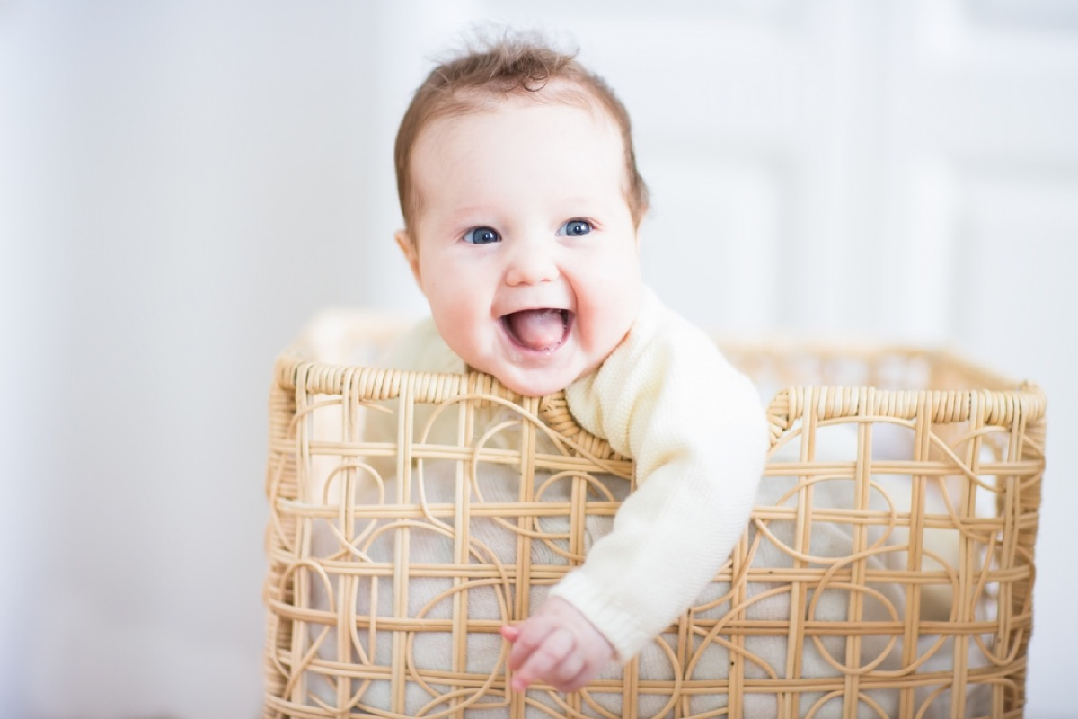 baby playing in hamper, bad parenting advice