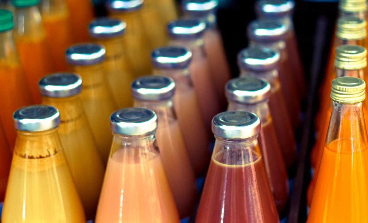 Vibrant Bottles of Juice Lined Up, Close-Up