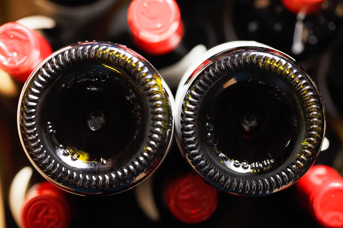 Wine bottle bottoms closeup photo