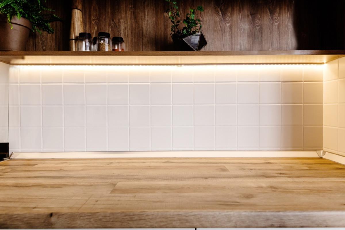 cabinet with under lighting, 80s interior design
