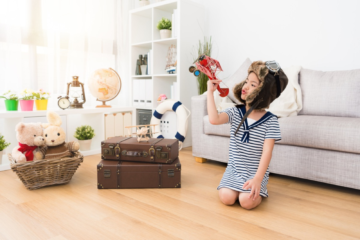 kid in playroom with antiques, skills parents should teach kids