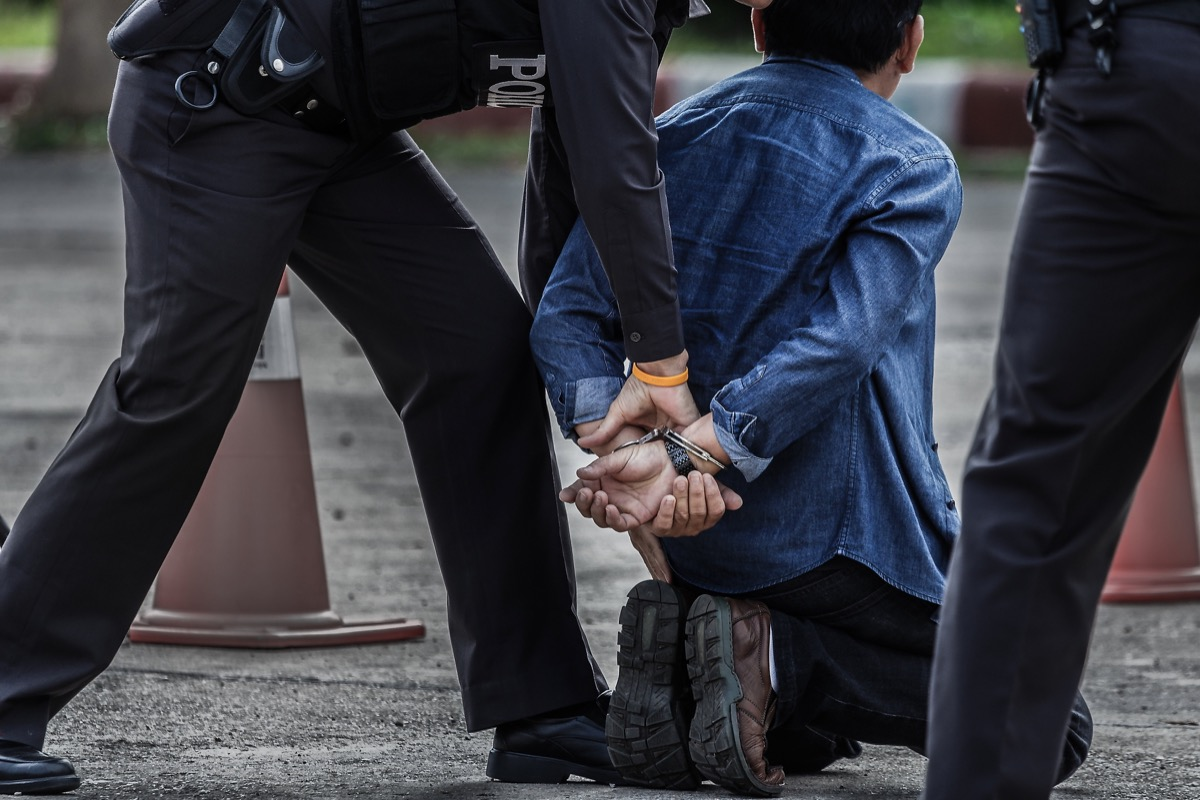 police officers arresting a man, safety tips