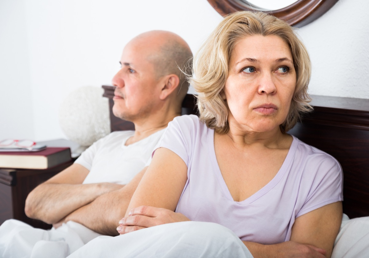 older couple fighting in bed, health questions after 50