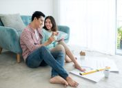 young asian couple discussing house renovation plans