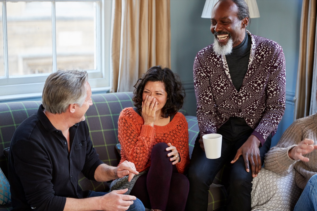 couple talking and laughing in a group, better husband
