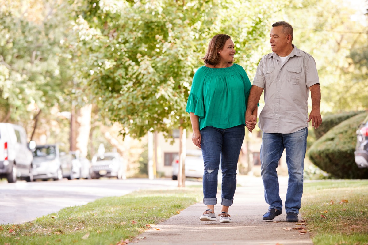 couple walking and talking together, healthier man