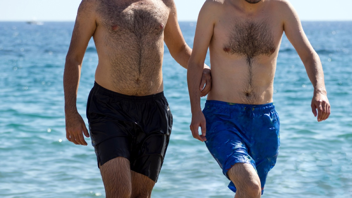 men on the beach in swim trunks, make yourself more attractive