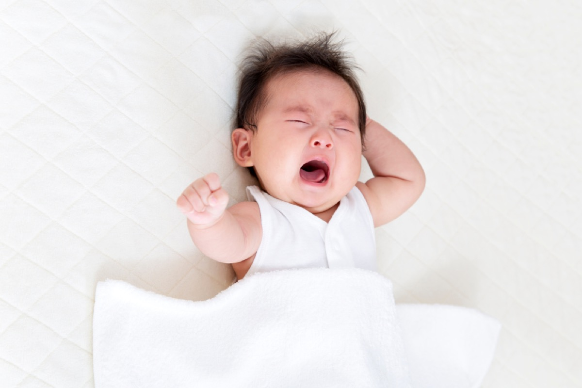 newborn baby crying in bed, bad parenting
