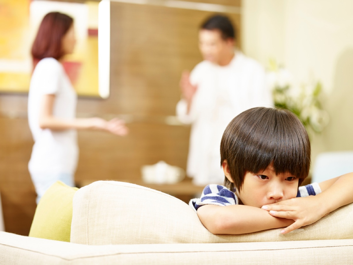 sad boy with parents fighting in the background, things you should never lie to kids about