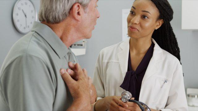 older man talking to young female doctor, school nurse secrets