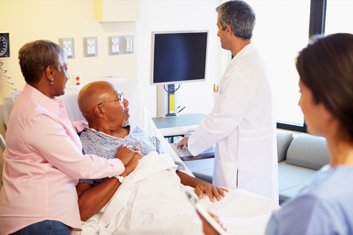 patient and doctor looking at test results, heart risk factors