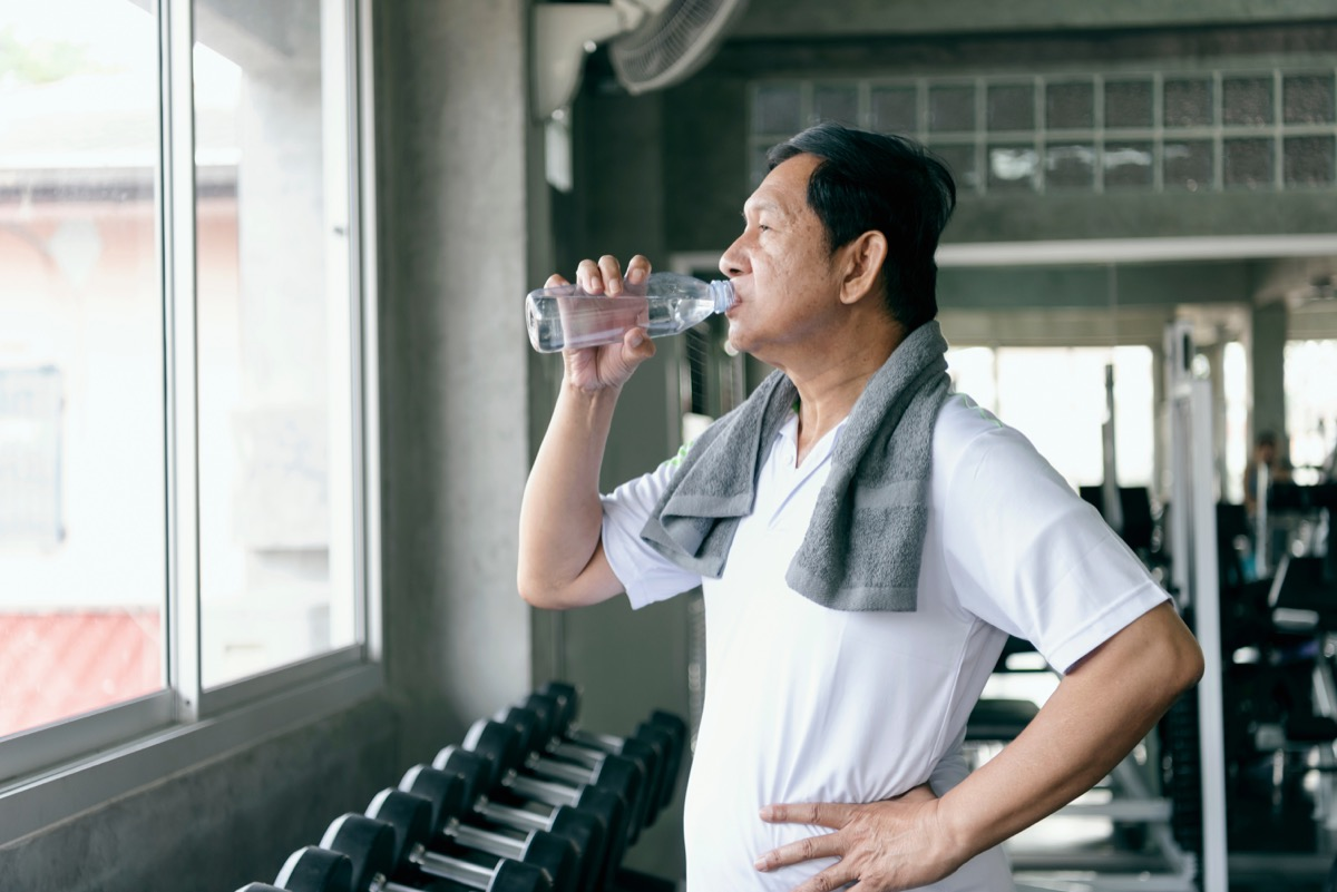 old man drinking water after exercising, look better after 40