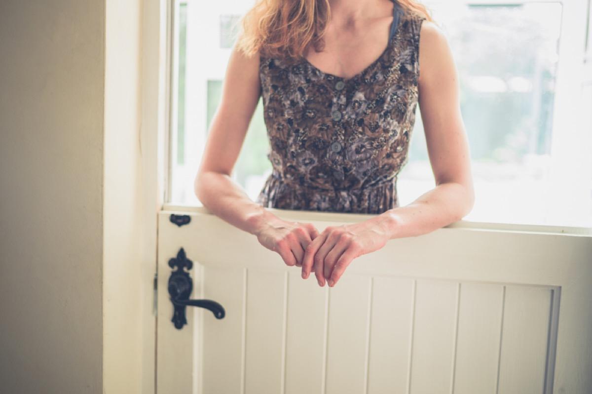 woman standing over stable door, vintage home upgrades