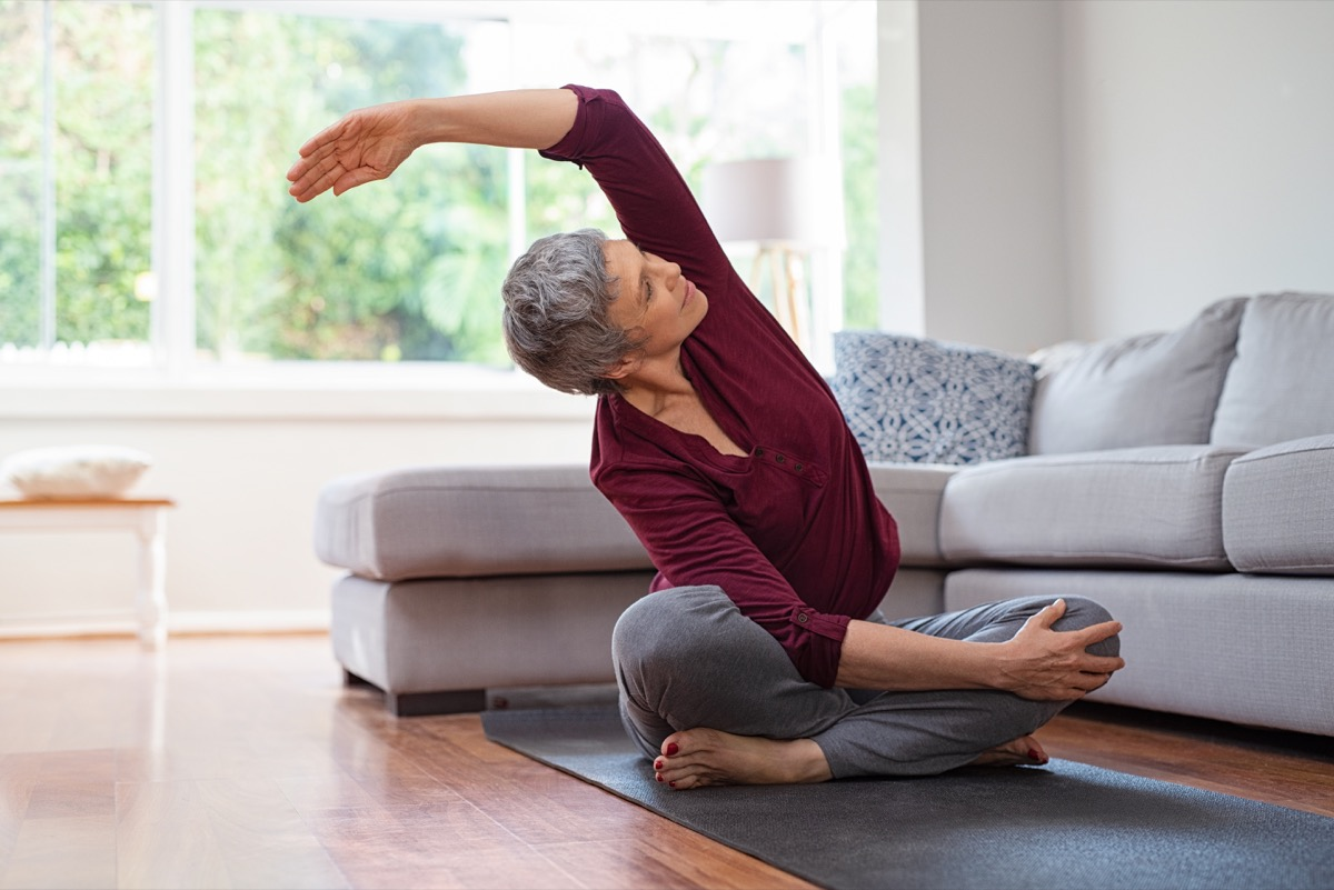 woman exercising at home, over 40 fitness