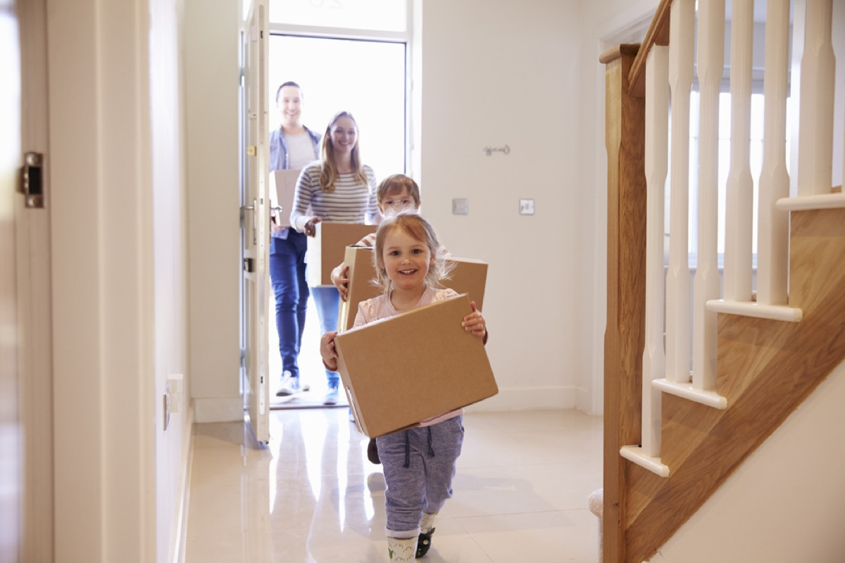 family carrying moving boxes, ways parenting has changed.