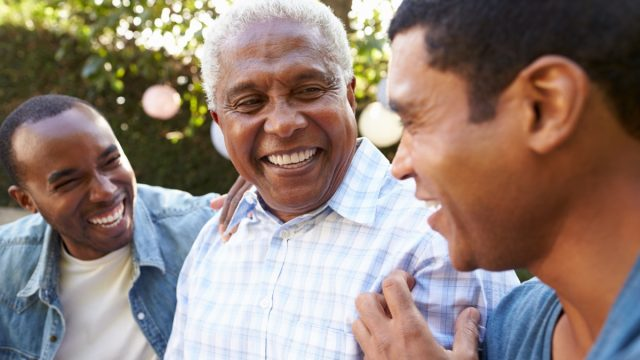 father laughing with his sons, smart person habits