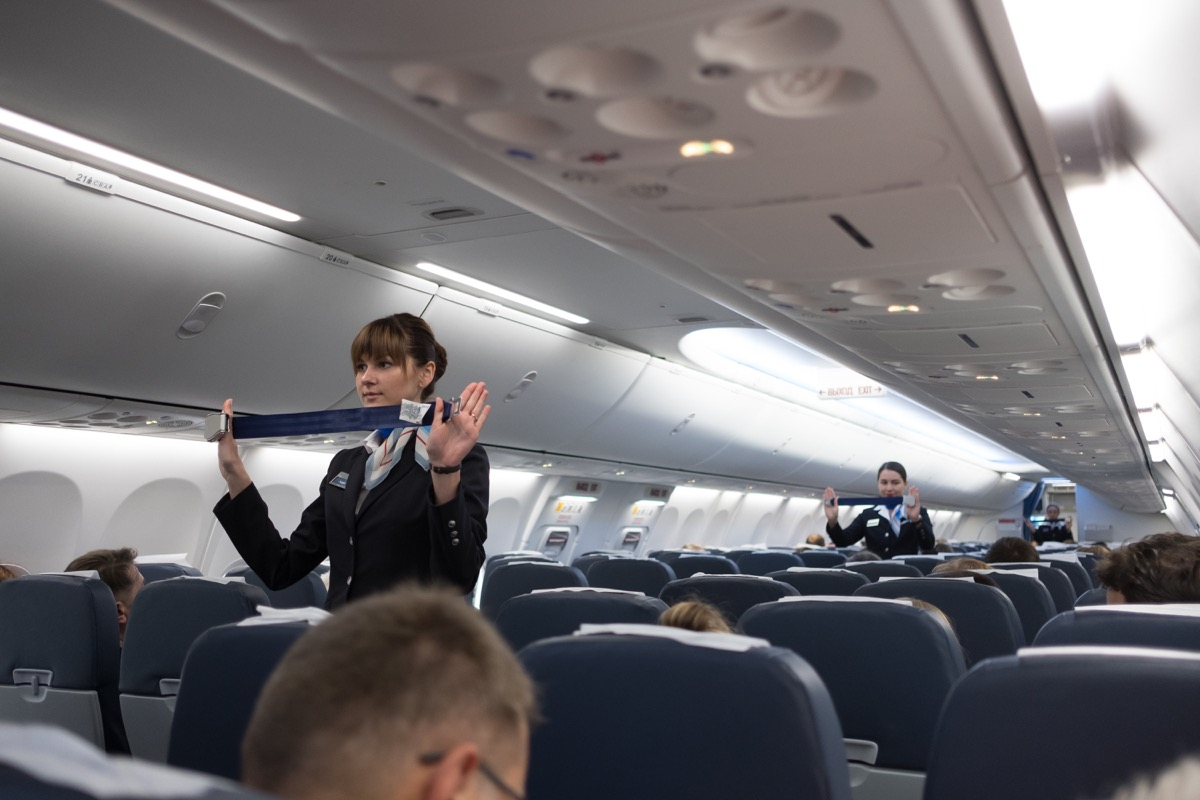 flight attendant displaying safety measures on airplane things that horrify flight attendants