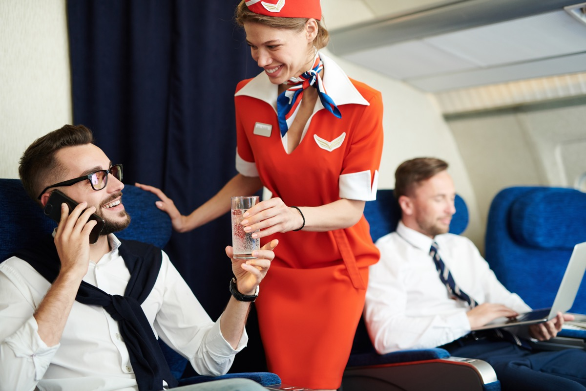 flight attendant talking to man on airplane things that horrify flight attendants