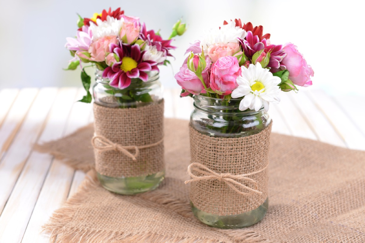 glass jars with wildflowers and burlap accent, joanna gaines tips