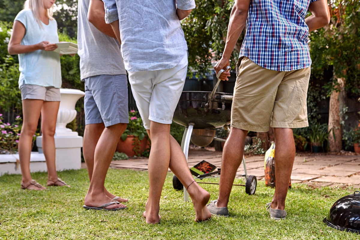 Friends at a Backyard Barbecue Party BBQ Etiquette Mistakes