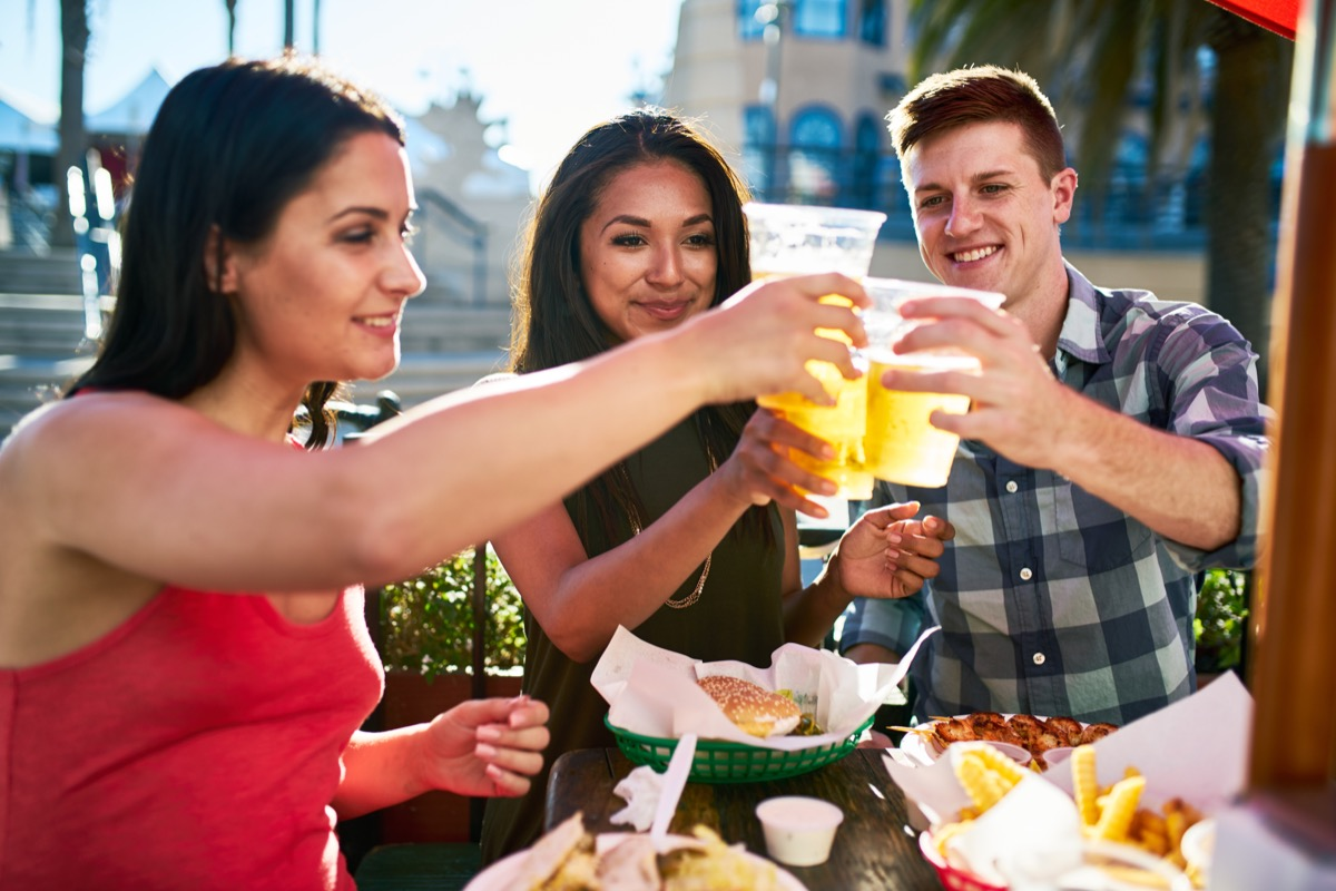 Friends Drinking Beers Outdoors BBQ Etiquette Mistakes