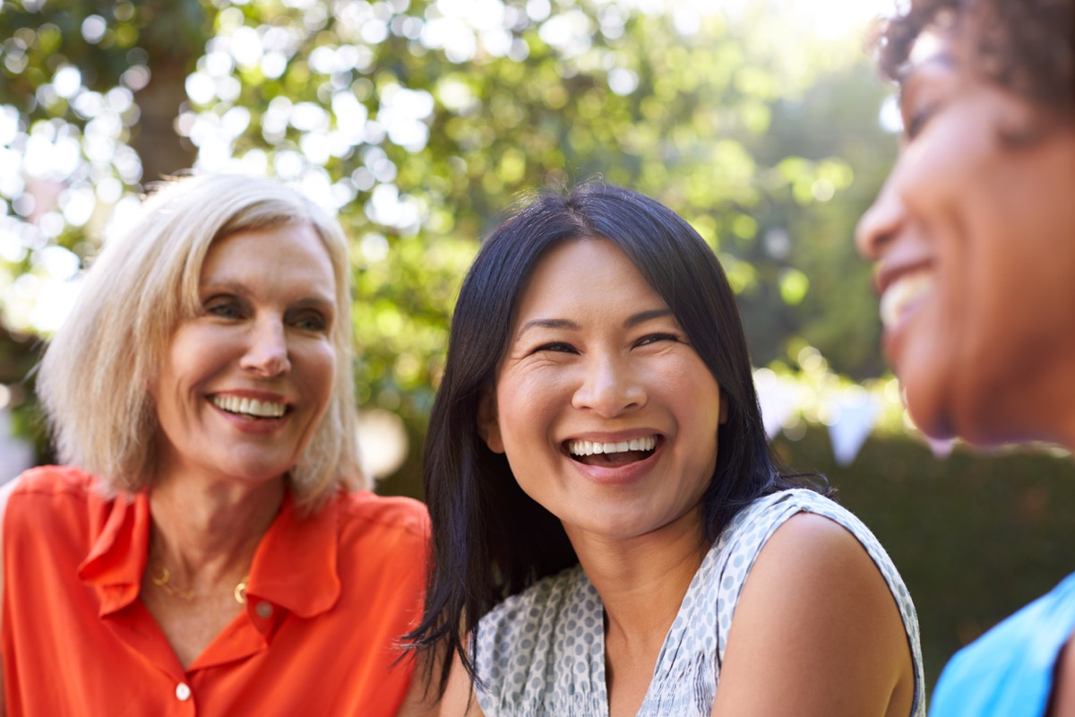 group of friends laughing, empty nest