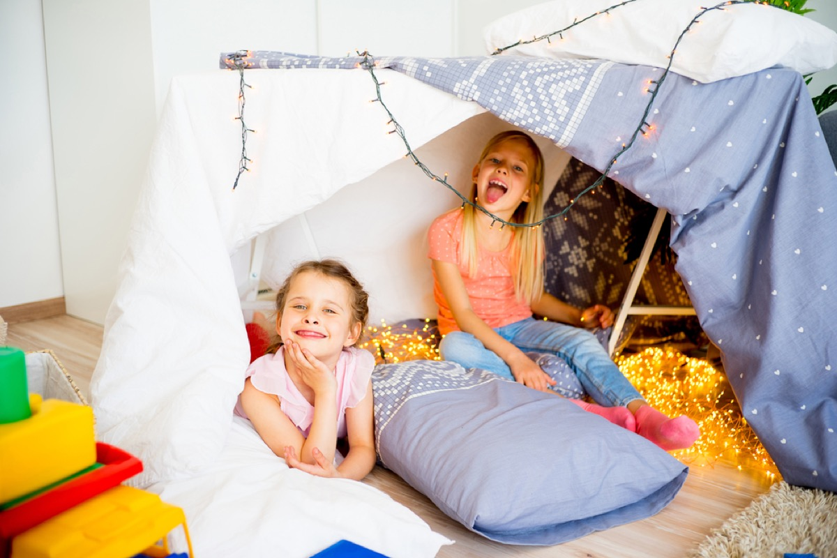 two young girls having slumber party in tent, bad parenting advice