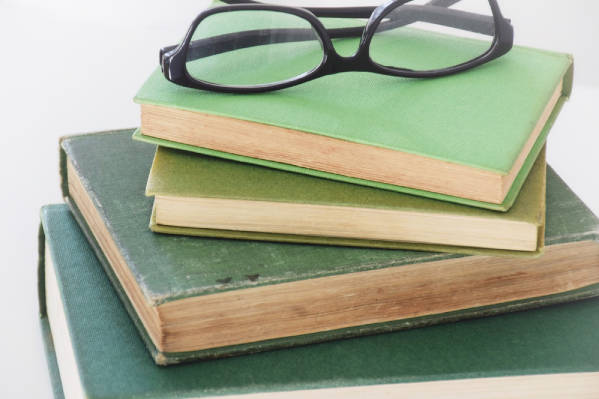 green books stacked with glasses on top, joanna gaines tips