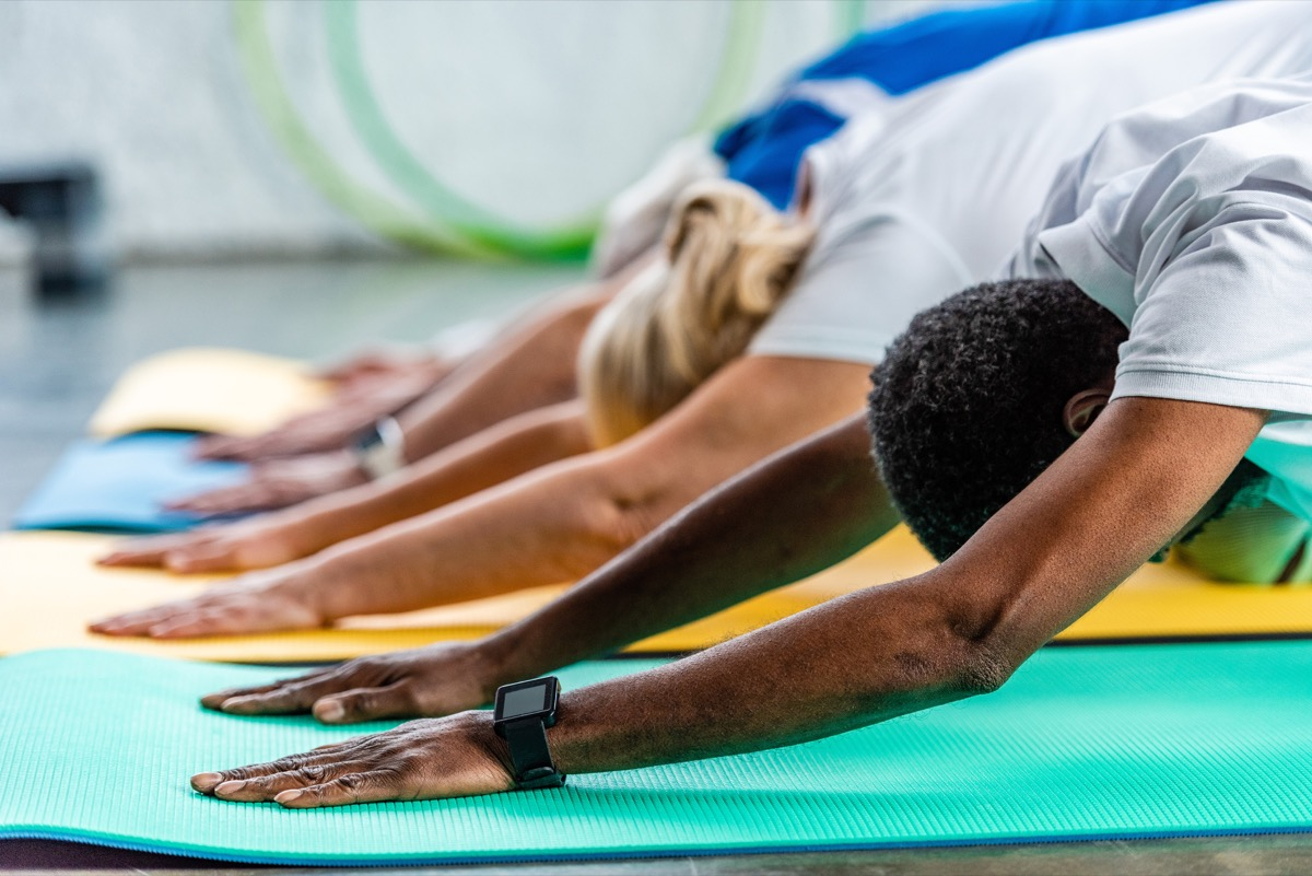 group exercising with yoga, over 40 fitness