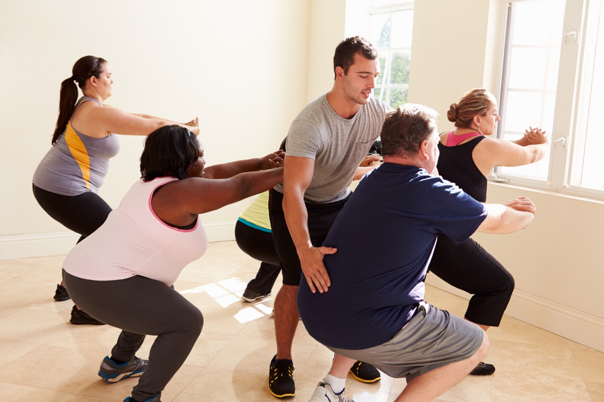 group working out and exercising, over 40 fitness